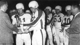 1951 Razorbacks accepting trophy